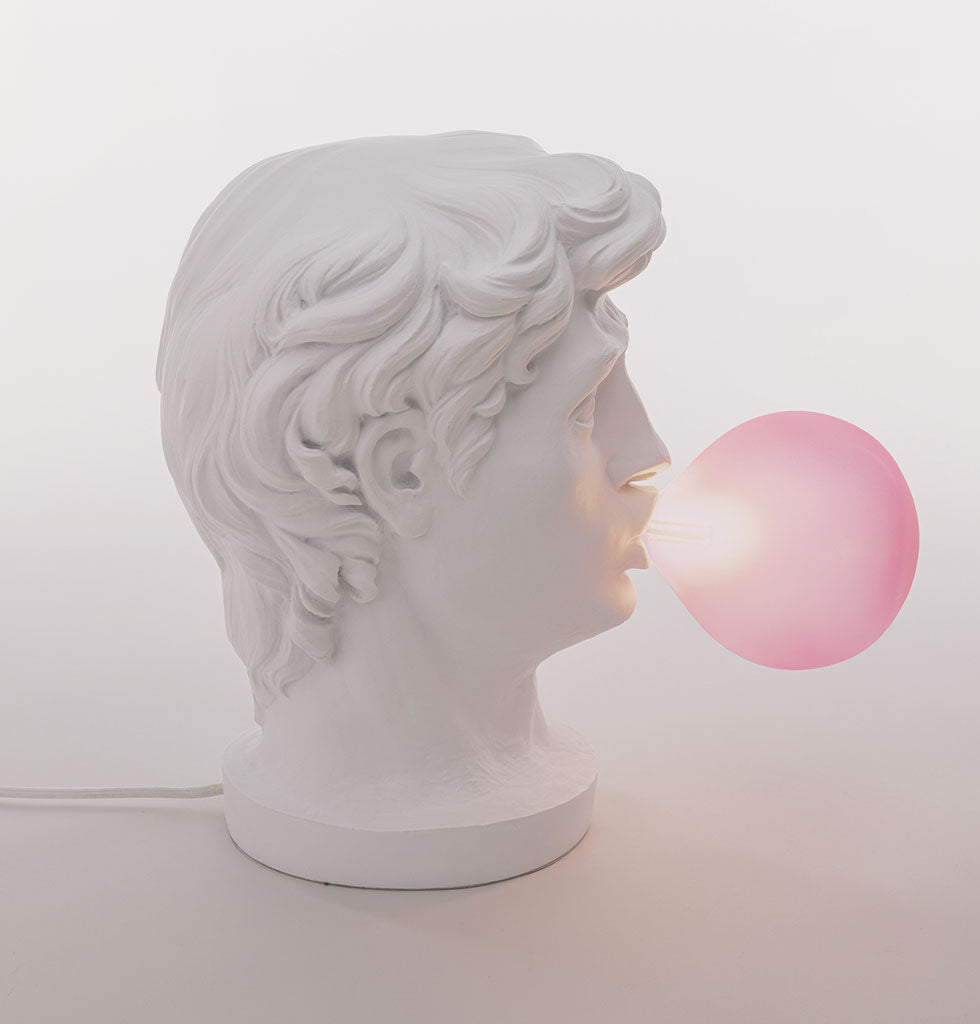 Occasional lamp featuring the white head of a man blowing a pink bubble. £239 wagreen.co.uk