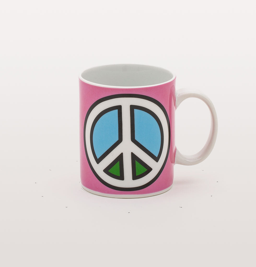 GIVE PEACE A CHANCE. This statement coffee mug sure is on message. The bold pink design with blue and green colours and iconic white peace symbol will make your morning coffee affirmation have all the more meaning.   Blow Diner collection of mugs from Studio Job for Seletti.