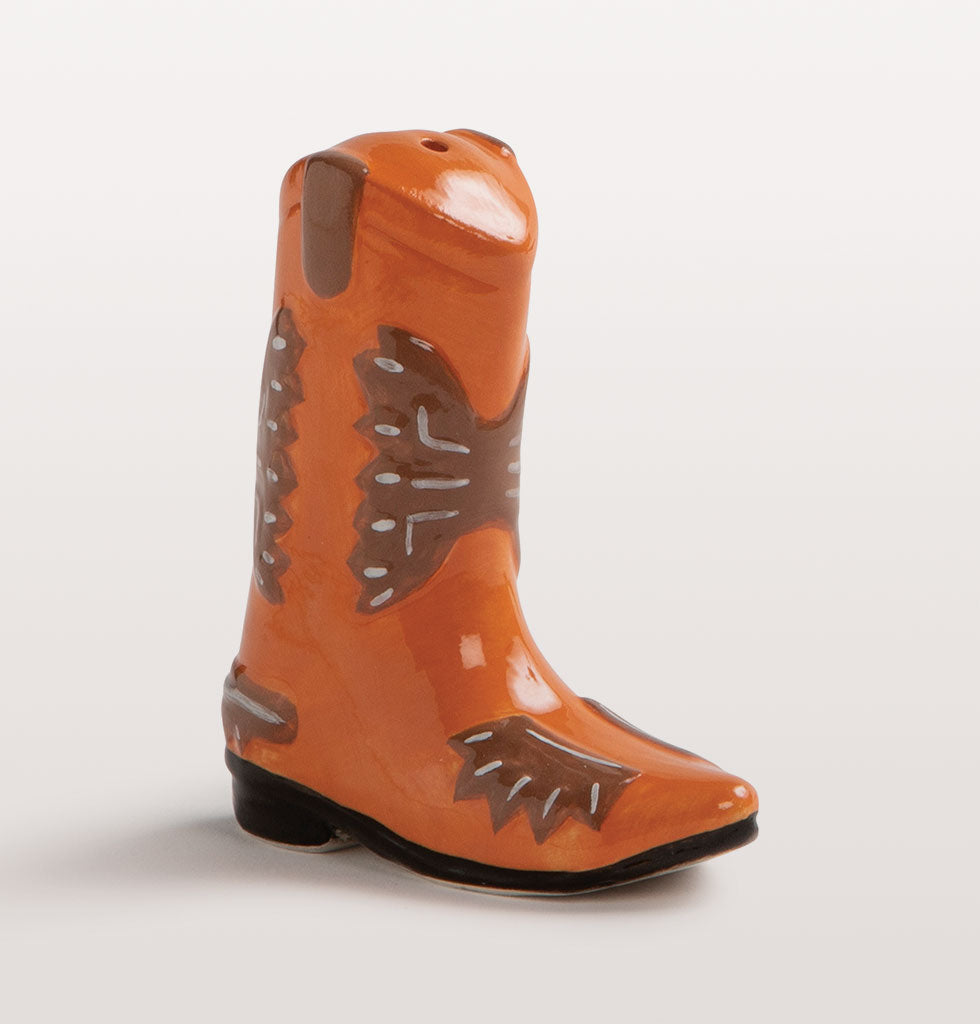Saddle up with some western style table seasoning. These cute cowboy boot salt and pepper shakers will have you line dancing around your dinner table.   Two piece orange and brown boot shaped salt and pepper set. Removable stoppers on the sole for refilling.