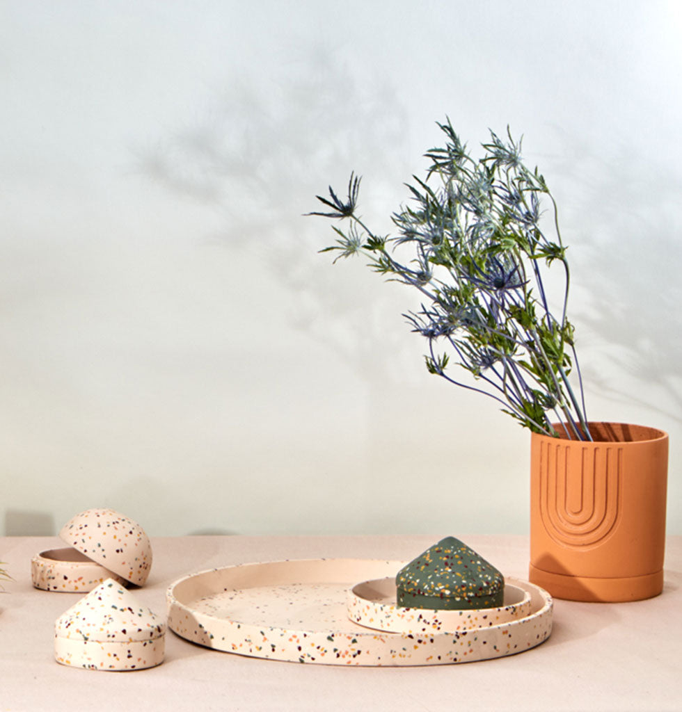 Capra Designs extra large round display tray in salt pink terrazzo. The perfect tray to place permanently as a table centrepiece, on a dresser for jewellery or as a kokadama tray and Etch desert planter. wagreen.co.uk