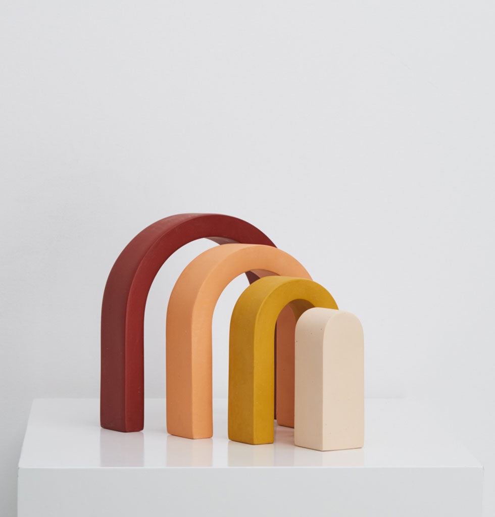 CAPRA DESIGNS | The Rainbow sculpture was inspired by the iconic California rainbow motif from the early 1970s and can be playfully assembled in different ways. The rainbow arches of cherry red, peach, sunshine yellow and white all compliment each other beautifully. £59 wagreen.co.uk