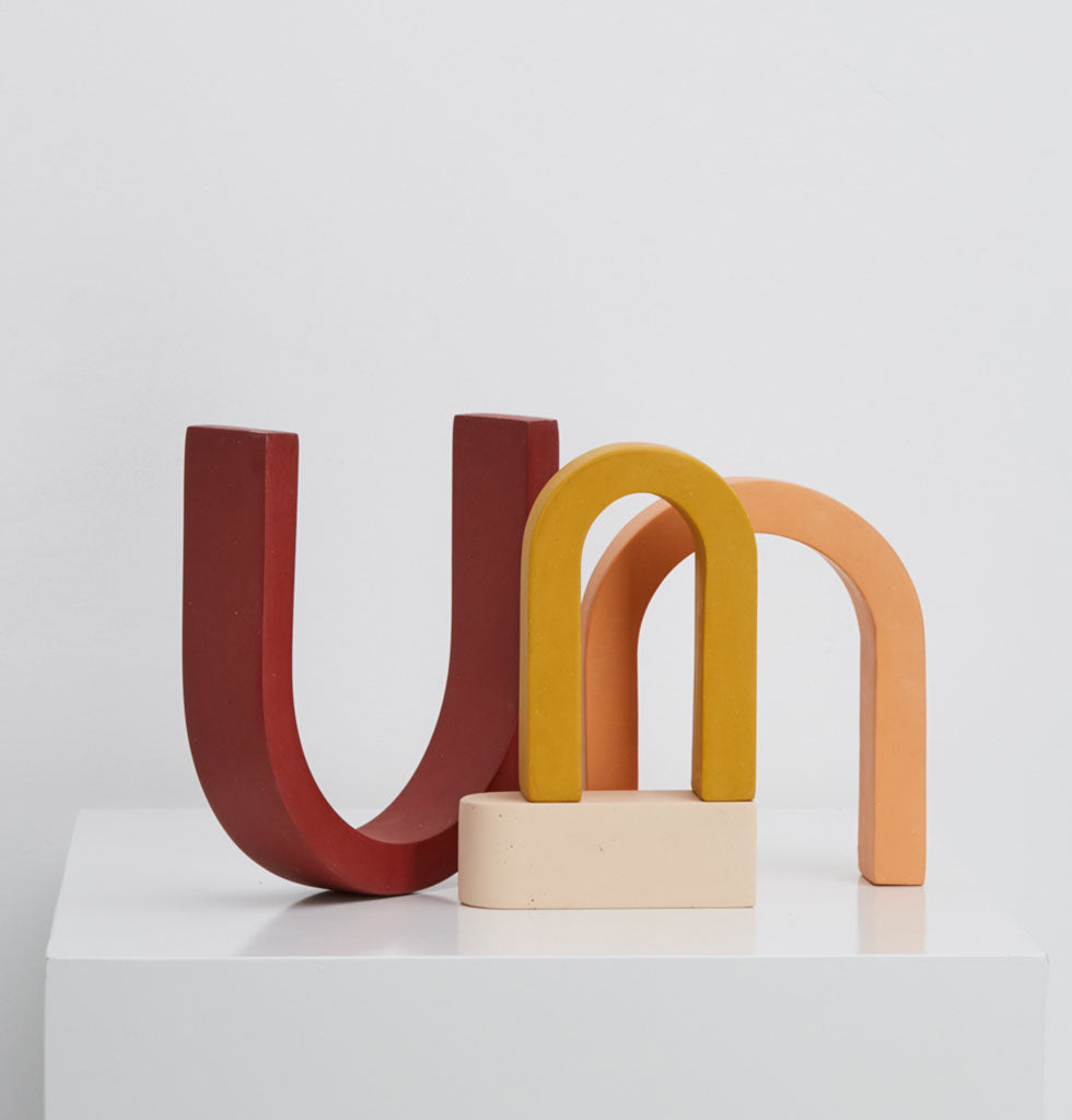 The Rainbow sculpture was inspired by the iconic California rainbow motif from the early 1970s and can be playfully assembled in different ways. The rainbow arches of cherry red, peach, sunshine yellow and white all compliment each other beautifully.