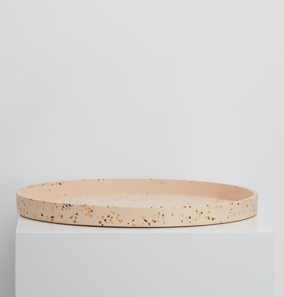 Capra Designs extra large round display tray in salt pink terrazzo. The perfect tray to place permanently as a table centrepiece, on a dresser for jewellery or as a kokadama tray. £55 wagreen.co.uk
