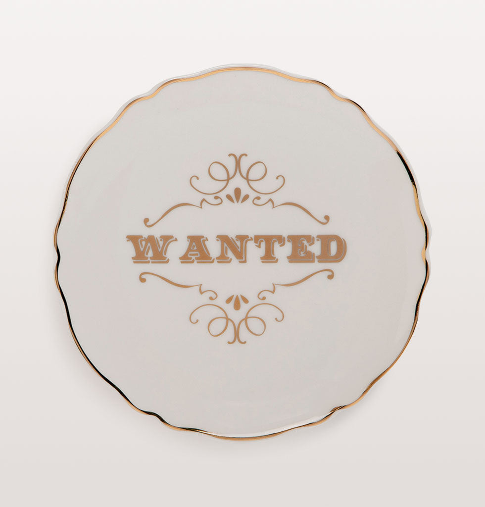 Wanted plate; Well Howdy Partner!  Pioneering western style plates with gold cowboy tribute slogans.  Six designs featuring: WANTED; HOWDY PARTNER; TALK SLOWLY, THINK QUICKLY; GIDDY UP; WET YOUR WHISTLE; REWARD  Small white bone china plates featuring different typographical phrases in cowboy style gold lettering.
