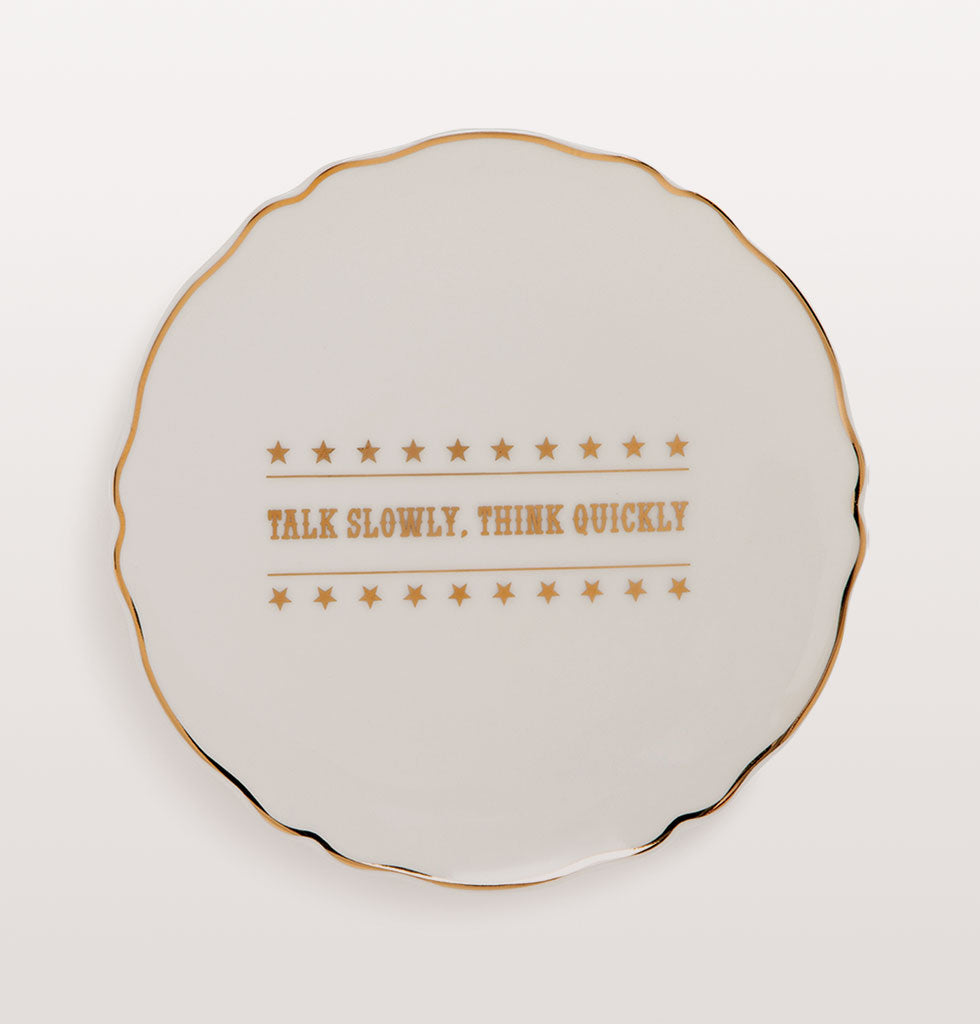 Well Howdy Partner!  Pioneering western style plates with gold cowboy tribute slogans.  Six designs featuring: WANTED; HOWDY PARTNER; TALK SLOWLY, THINK QUICKLY; GIDDY UP; WET YOUR WHISTLE; REWARD  Small white bone china plates featuring different typographical phrases in cowboy style gold lettering.