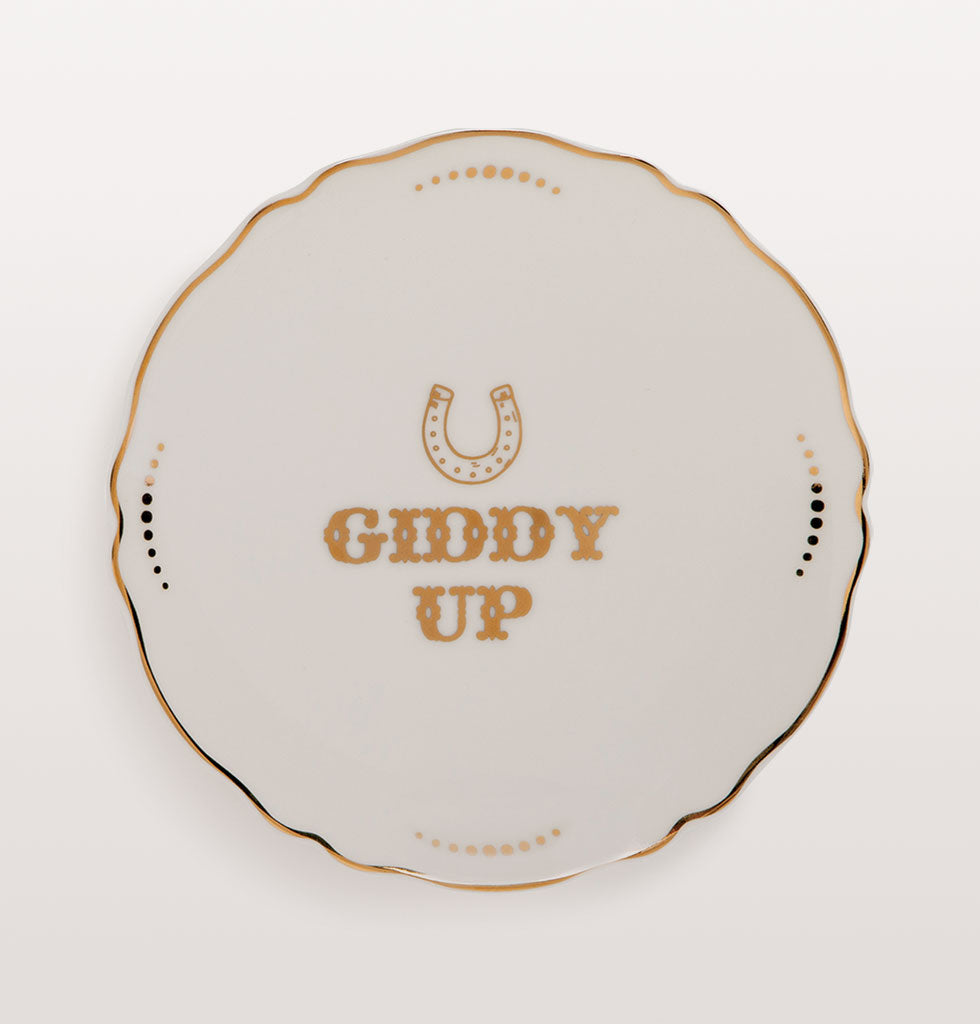Well Howdy Partner! Pioneering western style plates with gold cowboy tribute slogans. Six designs featuring: WANTED • HOWDY PARTNER • TALK SLOWLY • THINK QUICKLY • GIDDY UP • WET YOUR WHISTLE •REWARD  Small white bone china plates featuring different typographical phrases in cowboy style gold lettering. £12 wagreen.co.uk