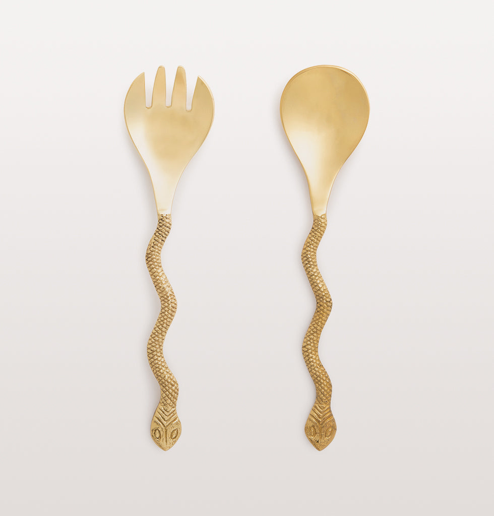 "Feel naughty about eating salad with these daring snake shaped salad servers.  The set of two gold snake salad serving spoons are made from brass. Presented in a smart gift box, these would make a memorable host gift or wedding present for a glamorous friend.    W.A.Green says, ""Sssalad hasss never been ssso sssultry.""  Set of two gold salad servers. Coordinates with the gold snake spoon set."
