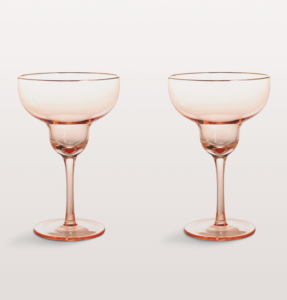 Nothing says cocktail hour to us like a Margarita. These beautiful soft pink traditional margarita glasses make for an elevated cocktail evening with style.  Edged with a smart gold ring these elegant pink glasses are perfect for any festive party.  Set of two cocktail glasses, presented in gift box.