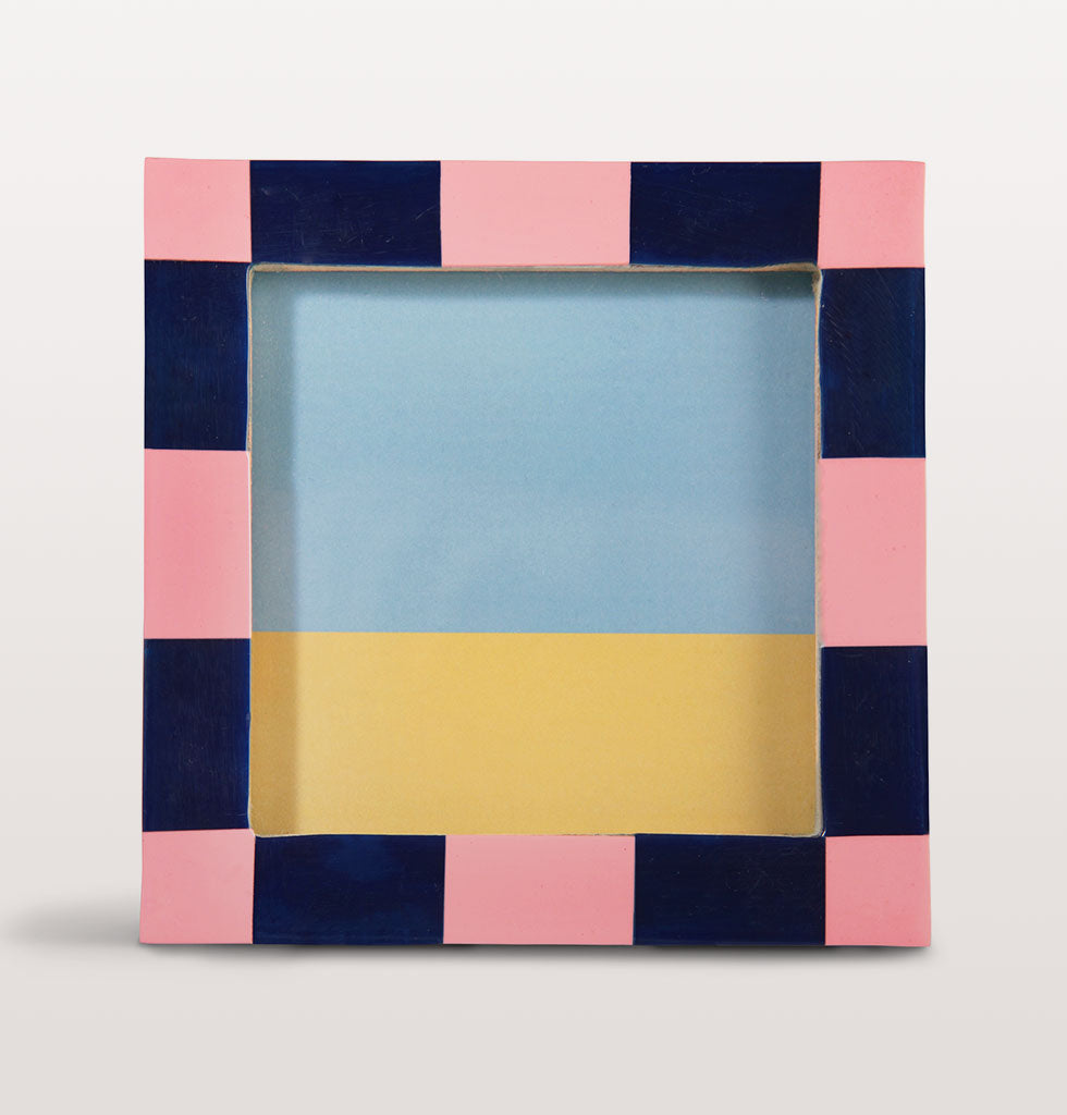W.A.GREEN | &K | A photo frame is an easy way to instantly update your interiors. This funky and chunky pink and navy check picture frame will add the wow factor to any shelf or side table.  The small modern square frame is perfect for keeping your favourite memories dotted around the home. £18 wagreen.co.uk