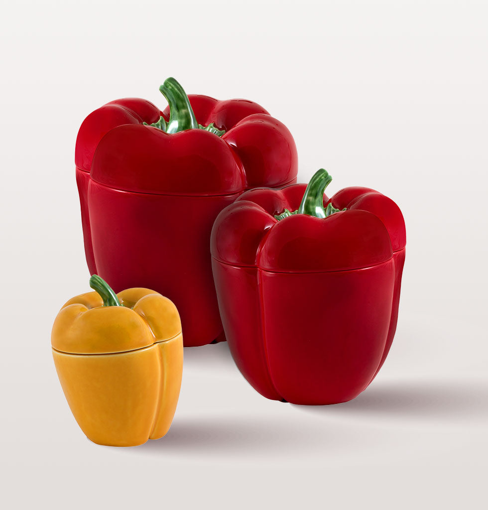 Small yellow, medium red and large red Pimento Pepper pot by Bordallo Pinheiro. wagreen.co.uk