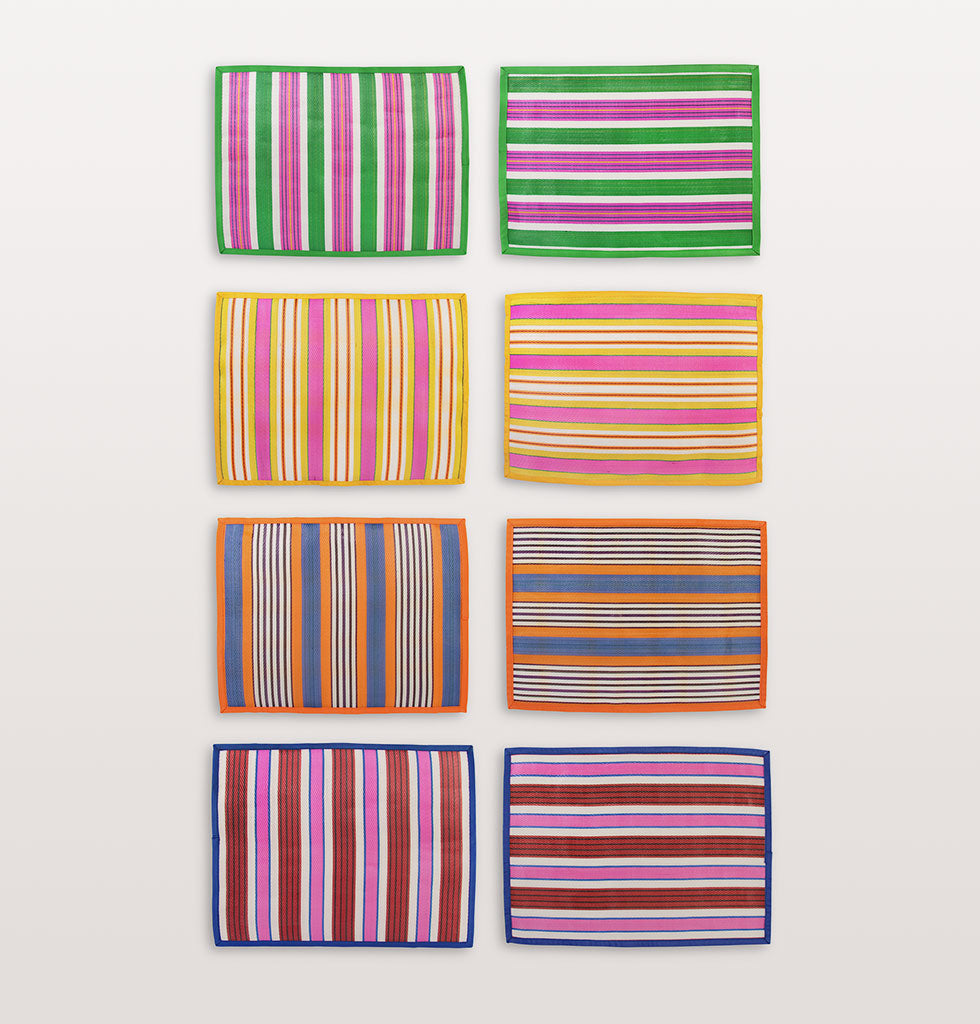 "W.A.GREEN | &K | Jazz up your table with these brightly striped summer placemats. The large rectangle shaped ticking striped placemats are easy to wipe clean and are made of recycled plastic.   W.A.Green says: ""We love the hot tropical colours of these recycled ticking striped tablemats"".  Set of 4 assorted placemats. £39 wagreen.co.uk"