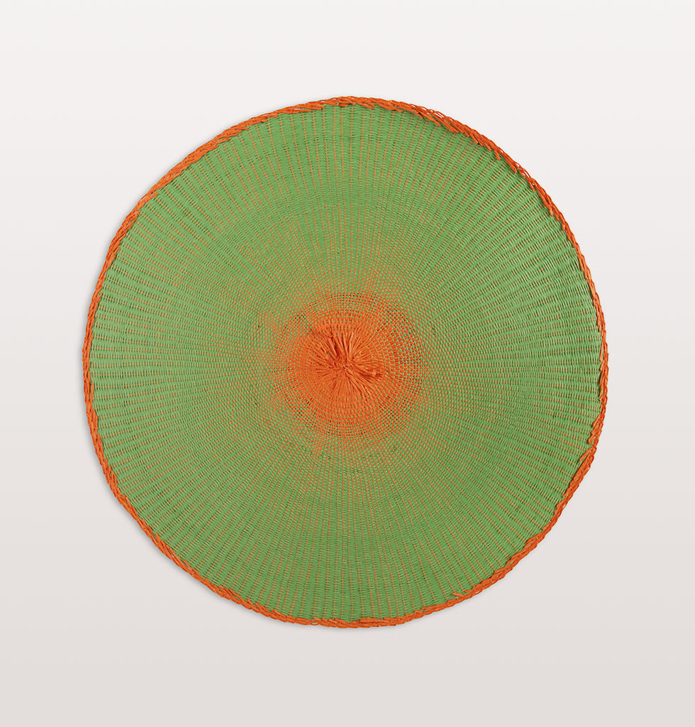 W.A.GREEN | &K | Entertaining at home is easy with these bright and bold placemats doing the hard work for you. Named after the colour wheel each round coloured rope mat has a strong contrasting colour at it's centre.  Natural round rope placements in funky colours. Green. £10.50 wagreen.co.uk