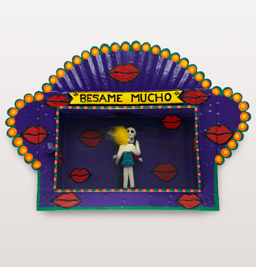 MILAGROS | Beśame Mucho - Kiss me now, kiss me with passion!   Unique Mexican hand crafted decorative tin nicho box depicting a gloriously seductive Day of the Dead skeleton kissing couple.   Mexican traditional tin crafted shadow box wall decoration. Large nicho box decorated with red lips featuring two characters kissing - what's not to love. £98 wagreen.co.uk