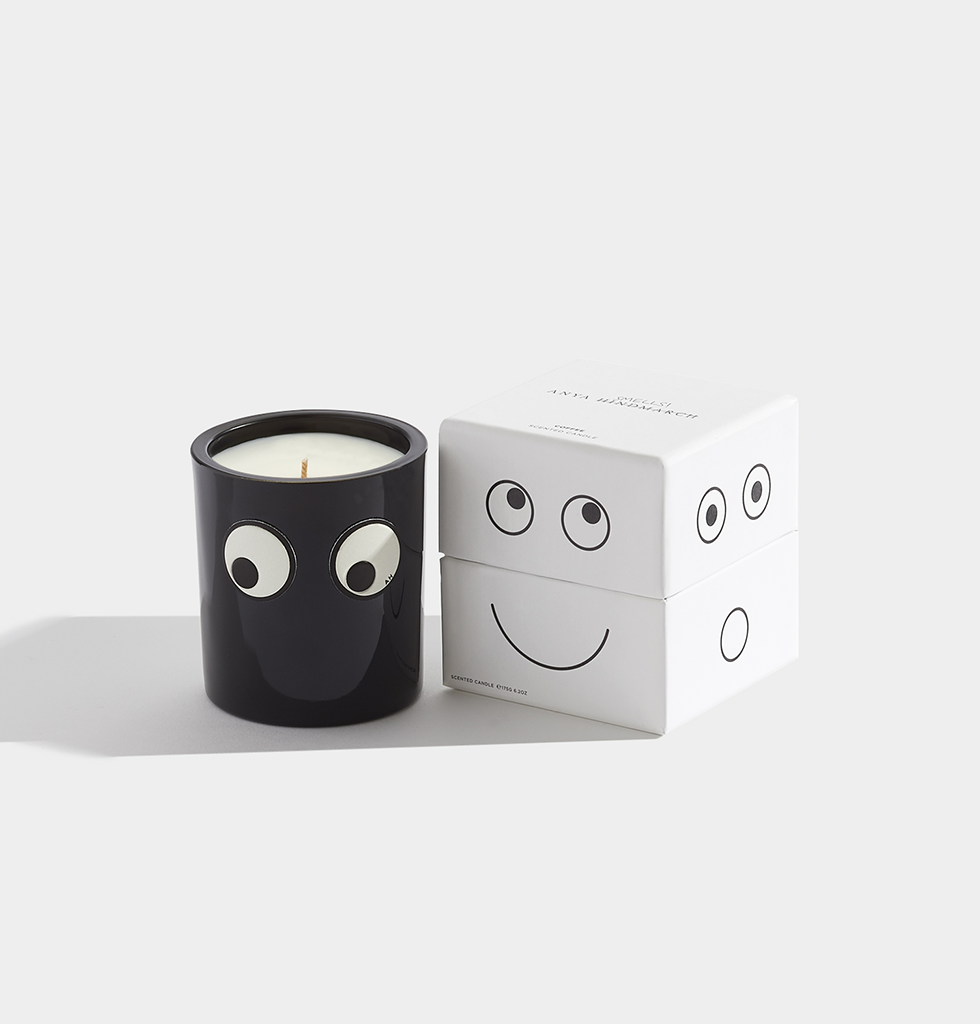 Anya smells by Anya Hindmarch, Coffee and woodsmoke candle. Goggle eyes logo, sticker, patch collectible fashionable gift.  Notes of café absolue, galbanum, cardamom, vetiver, patchouli, Virginia cedar wood, tonka bean, frankincense and amber.