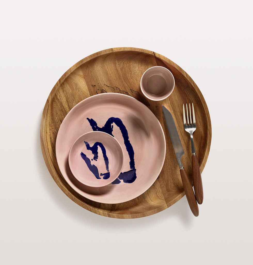 Ottolenghi x Serax. Delicious Pink and Pepper Blue small dish and high plate. Delicious Pink cup with Feast cutlery and wooden tray. wagreen.co.uk