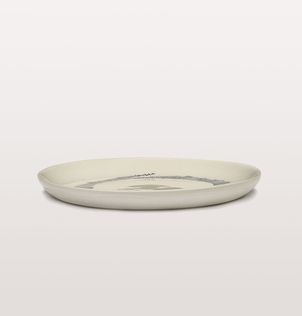 Ottolenghi x Serax. White & Swirl Stripes Blue small plate side view. £20 wagreen.co.uk