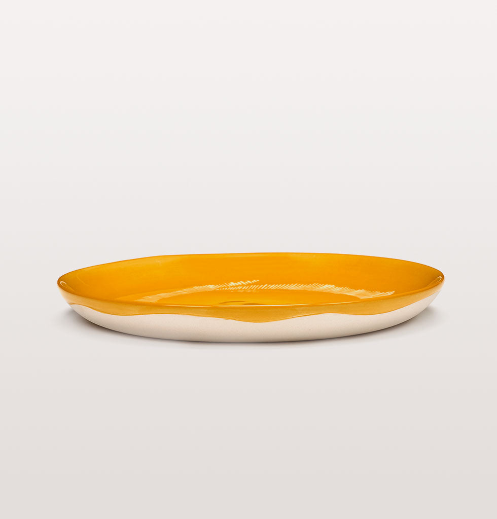 Ottolenghi x Serax. Sunny Yellow & Swirl Stripes White small plate side view. £20 wagreen.co.uk