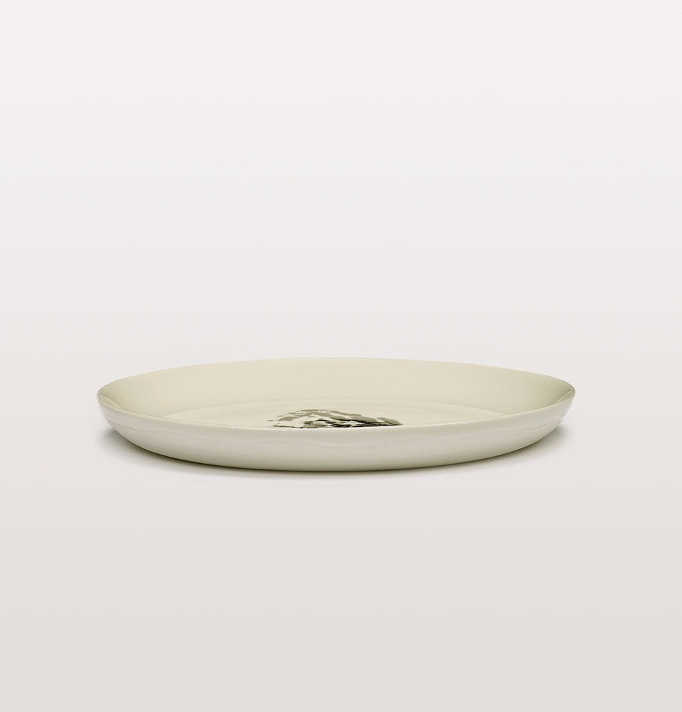 Ottolenghi x Serax. White & Artichoke Black small plate side view. £20 wagreen.co.uk