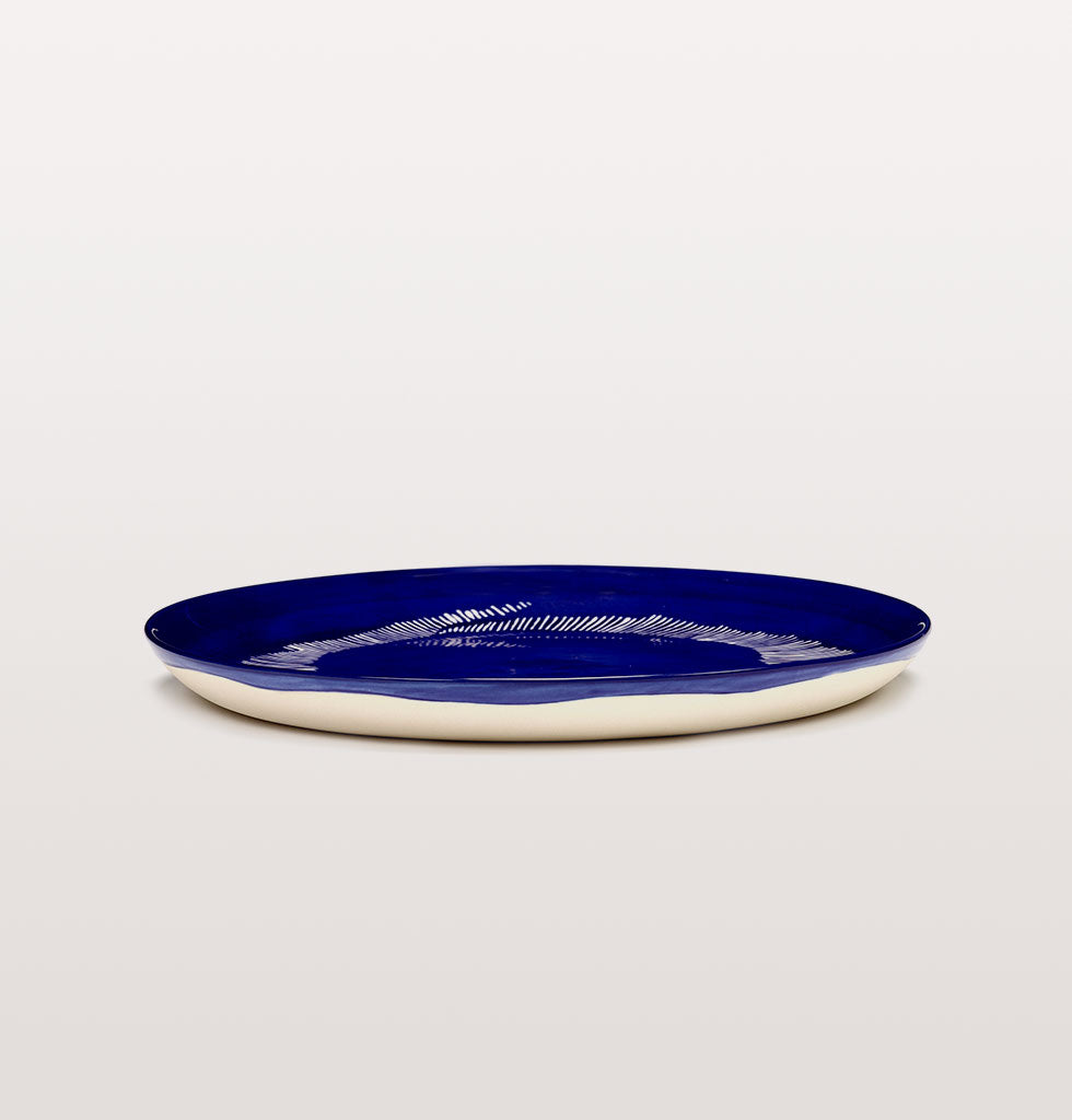 Ottolenghi x Serax. Lapis Lazuli and Swirl Stripes White medium plate side view. £25 wagreen.co.uk