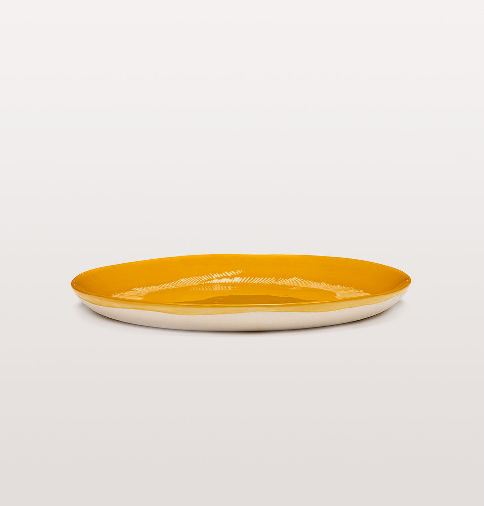 Ottolenghi x Serax. Sunny Yellow and Swirl Stripes White medium plate side view. £25 wagreen.co.uk