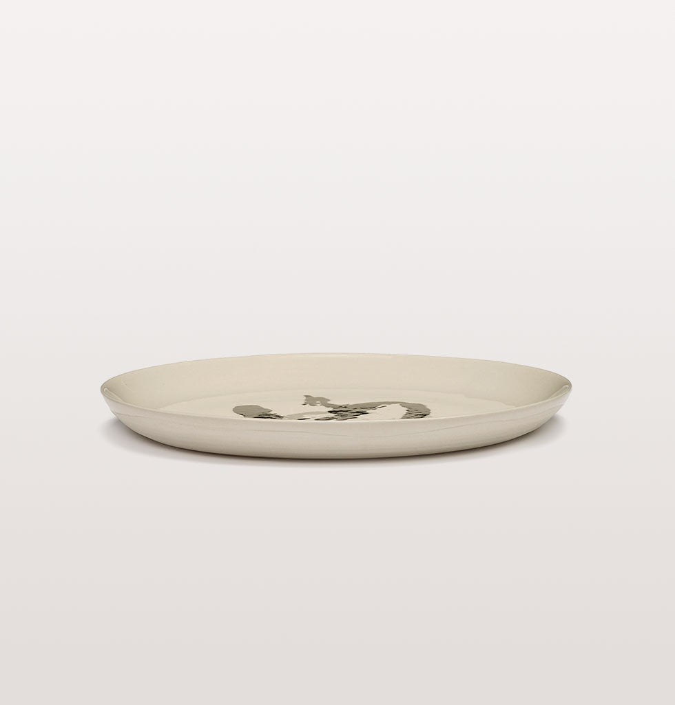 Ottolenghi x Serax. White and Pepper Black medium plate side view. £25 wagreen.co.uk