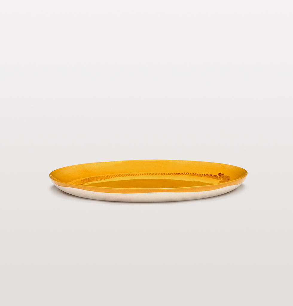 Ottolenghi x Serax. Sunny Yellow and Swirl Stripes Red large plate side view. £30 wagreen.co.uk