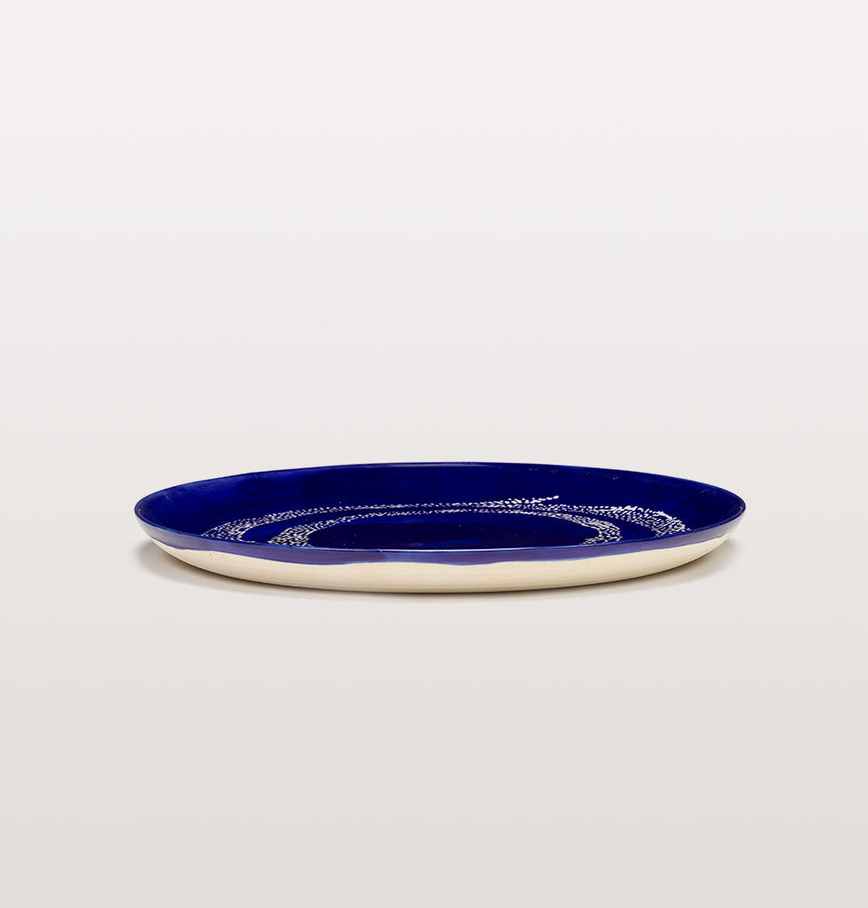 Ottolenghi x Serax. Lapis Lazuli and Swirl Dots White large plate side view. £30 wagreen.co.uk