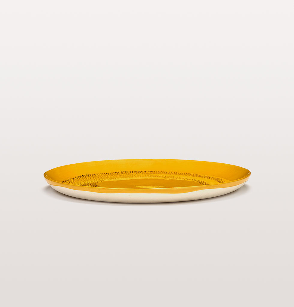Ottolenghi x Serax. Sunny Yellow and Swirl Dots Black side view. £30 wagreen.co.uk