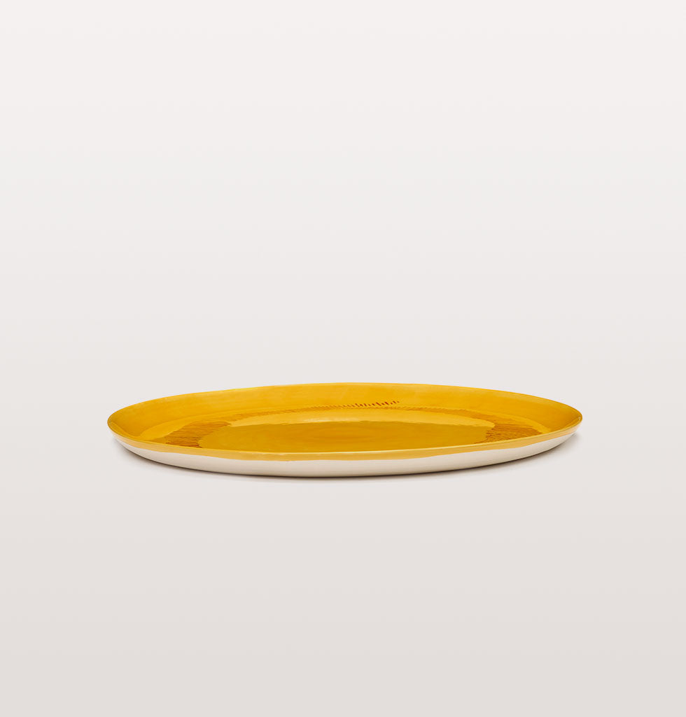 Ottolenghi x Serax. Sunny Yellow and Swirl Stripes Red serving plate side view. £67 wagreen.co.uk
