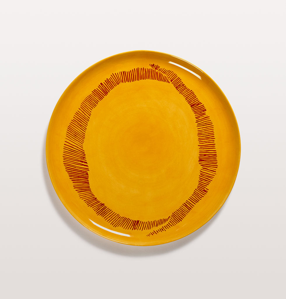 Ottolenghi x Serax. Sunny Yellow and Swirl Stripes Red serving plate. £67 wagreen.co.uk