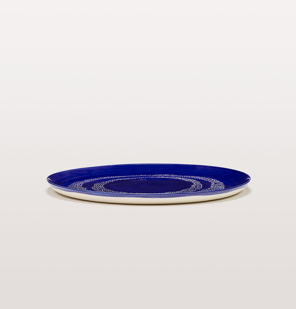 Ottolenghi x Serax. Lapis Lazuli and Swirl Dots White serving plate side view. £67 wagreen.co.uk