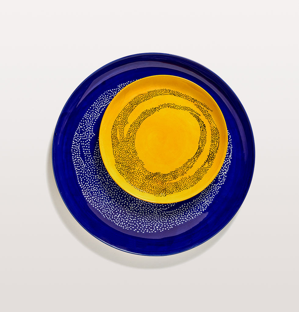 Ottolenghi x Serax. Lapis Lazuli and Swirl Dots White serving plate and Sunny Yellow and Swirl Dots Black medium plate. wagreen.co.uk