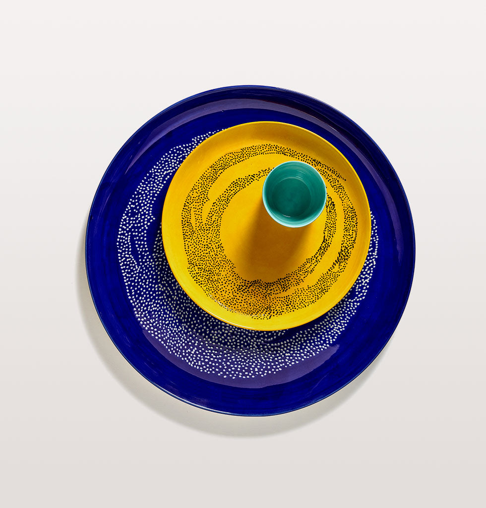 Ottolenghi x Serax. Lapis Lazuli and Swirl Dots White serving plate and Sunny Yellow and Swirl Dots Black medium plate with Azure and Swirl Stripes Red coffee cup. wagreen.co.uk