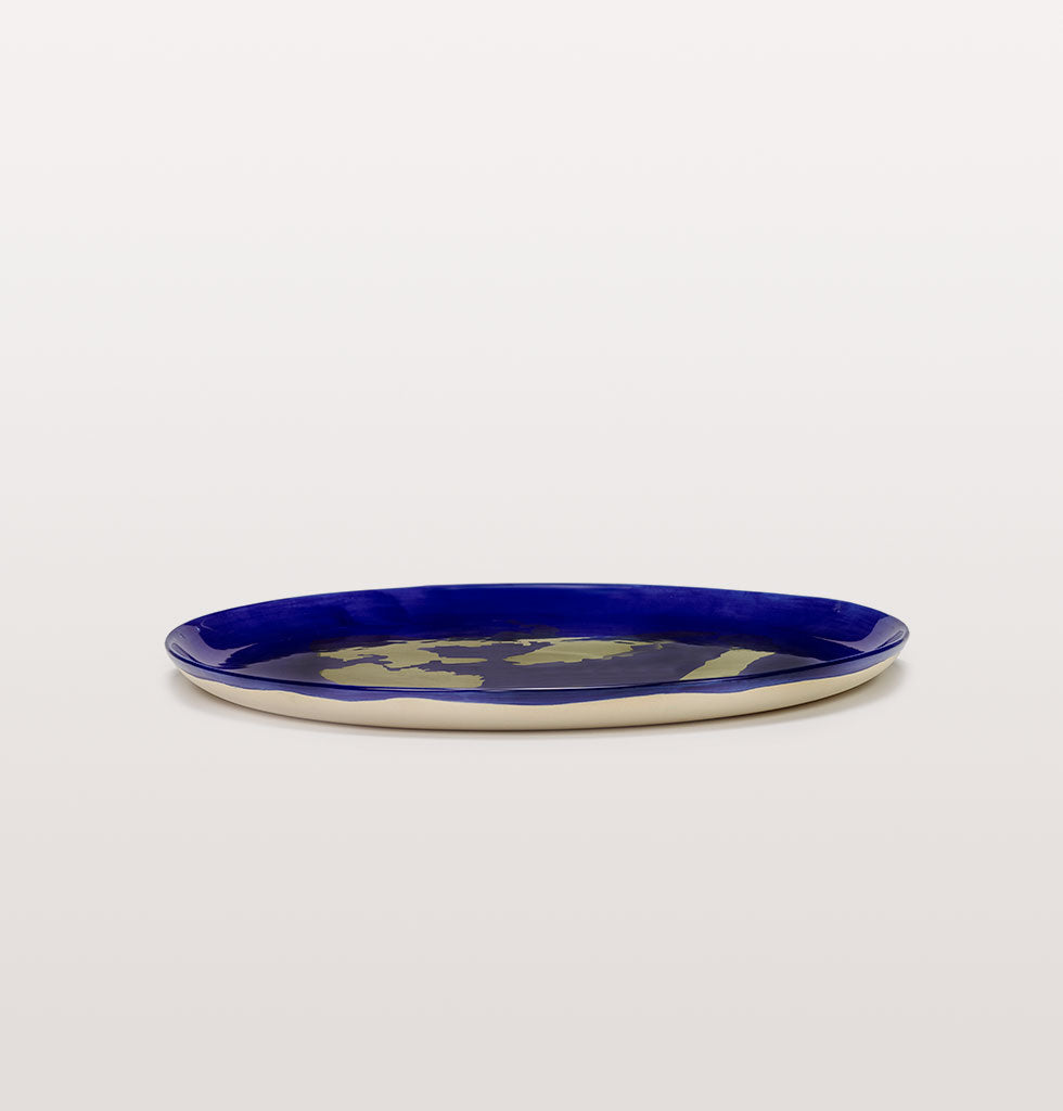 Ottolenghi x Serax. Lapis Lazuli and Pepper Gold serving plate side view. £85 wagreen.co.uk