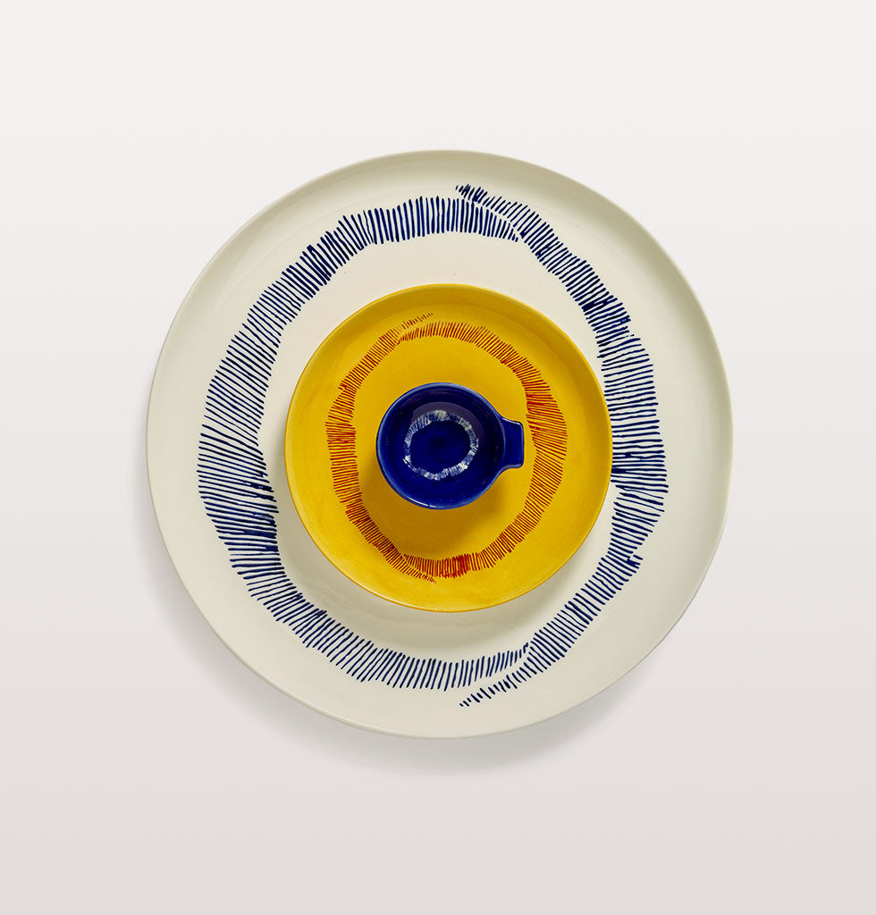 Ottolenghi x Serax. Lapis Lazuli and Swirl Stripes White small tapas plate, Sunny Yellow and Swirl Stripes Red small plate and White and Swirl Stripes Blue serving plate. wagreen.co.uk