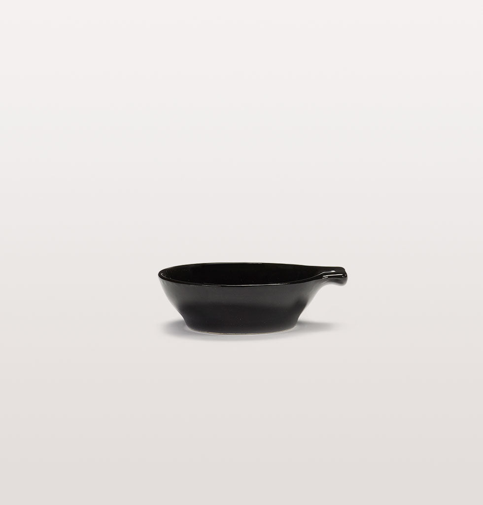 Ottolenghi x Serax. Black small tapas plate side view. £9 wagreen.co.uk