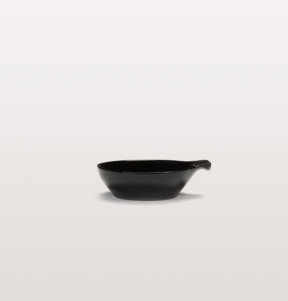 Ottolenghi x Serax. Black large tapas plate side view. £13 wagreen.co.uk