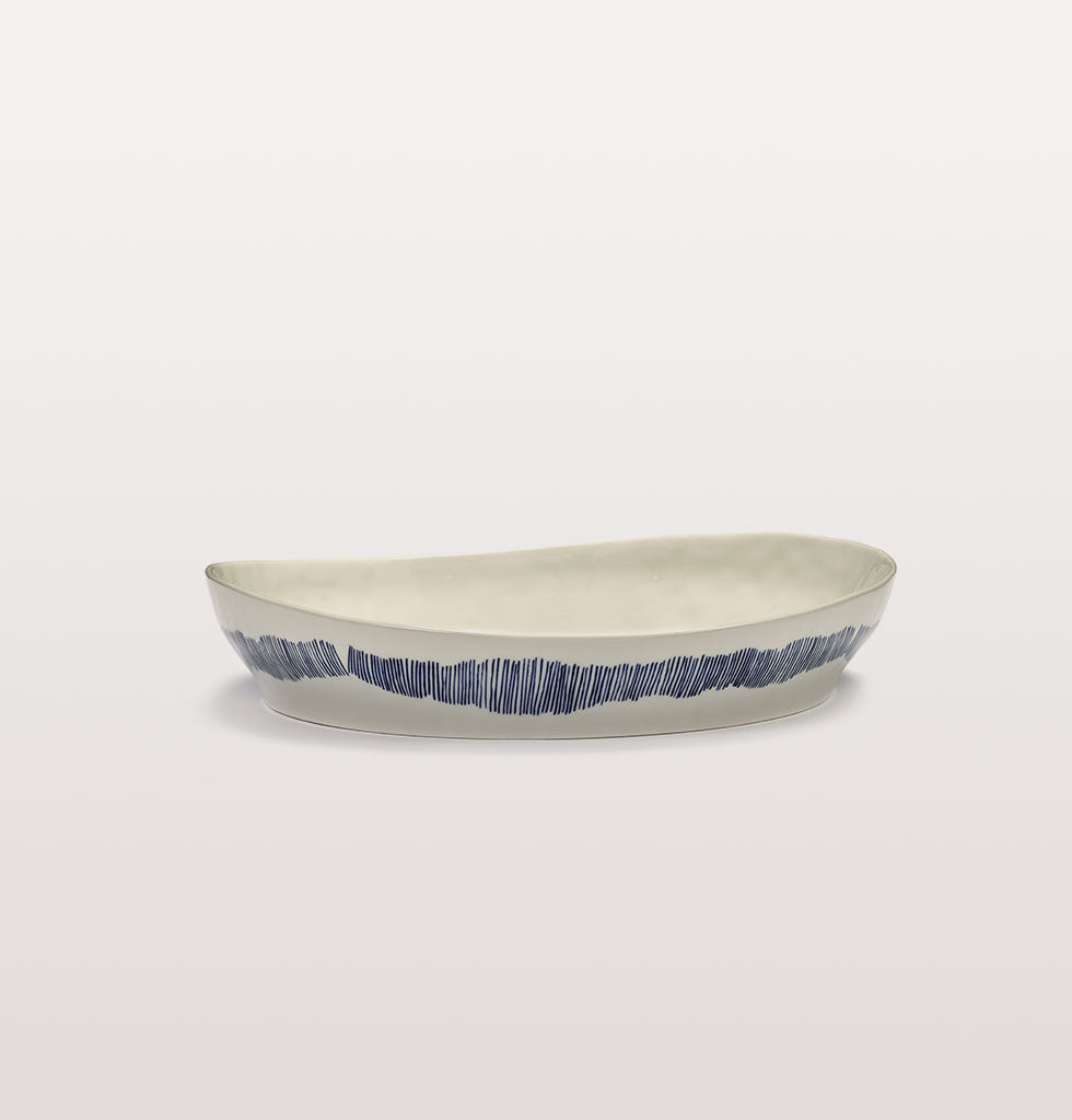 Ottolenghi x Serax. White and Swirl Stripes Blue small serving dish side view. £65 wagreen.co.uk