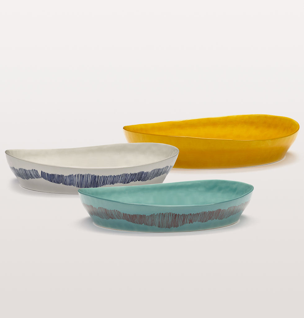 Small serving plates by Ottolenghi.  Simply delicious is how we describe the Feast serveware collection from chef Yotam Ottolenghi.  Famed for his complex flavours the guru of laid back dining has created a tableware collection as tasty as his cook book recipes and as convivial as his restaurants.  The serving dishes or plates are a lesson in refined casualness, informal but abundant in their colour and form. wagreen.co.uk