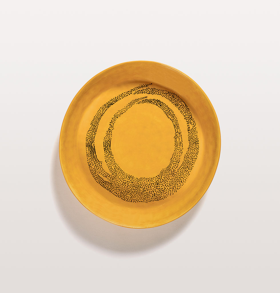 Ottolenghi x Serax. Sunny Yellow and Swirl Dots Black small serving dish top view. £65 wagreen.co.uk