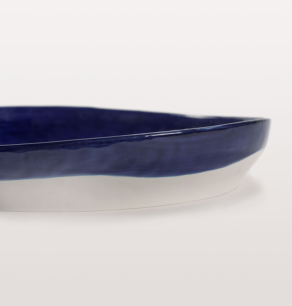 Ottolenghi x Serax. Lapis Lazuli and Swirl Dots White large serving plate side close up. £85 wagreen.co.uk