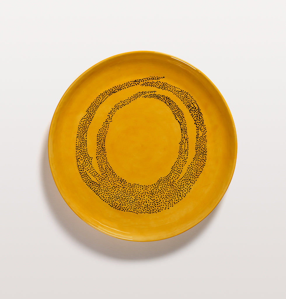 Ottolenghi x Serax. Sunny Yellow and Swirl Dots Black medium serving dish top view. £65 wagreen.co.uk