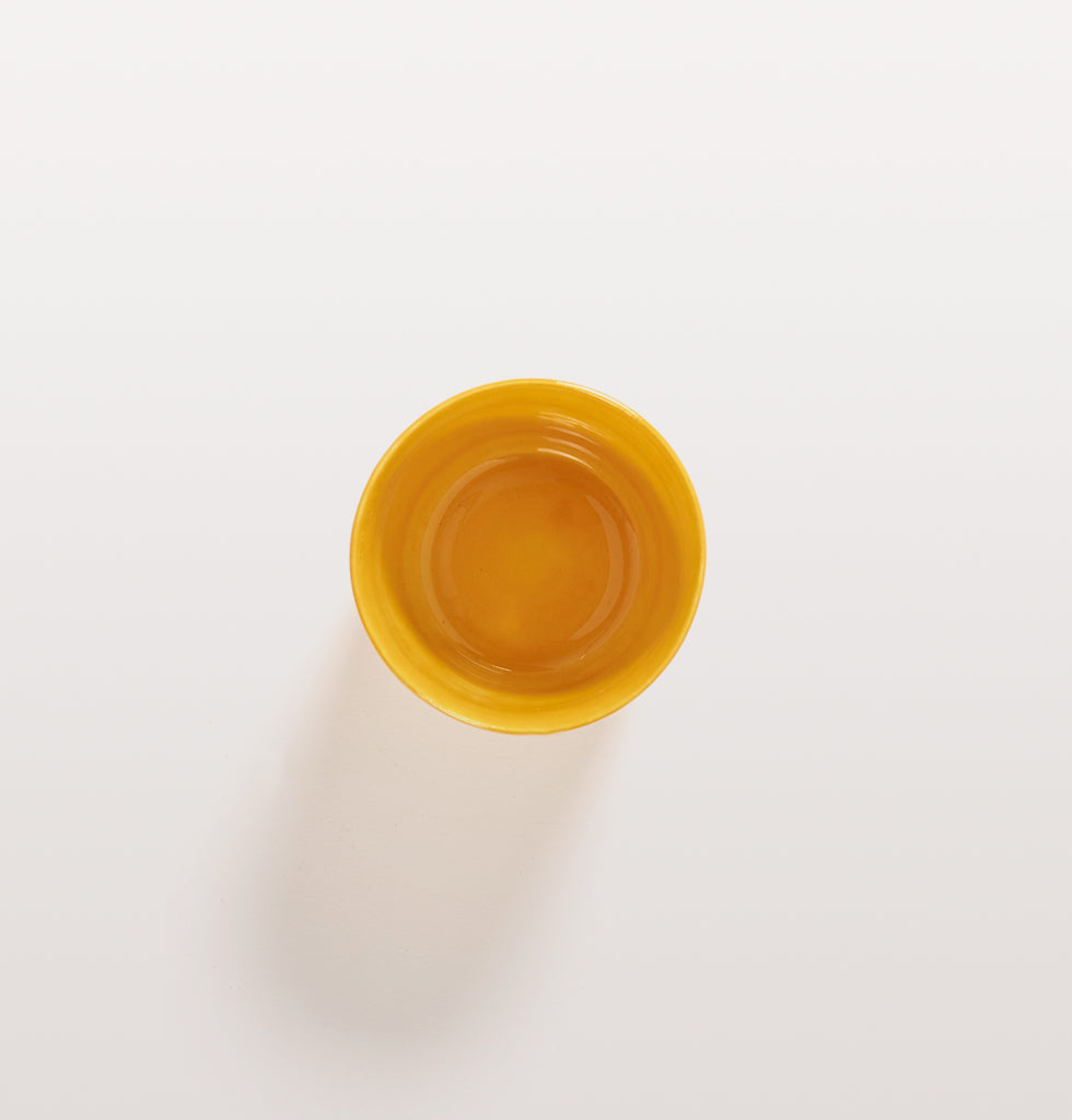 Ottolenghi x Serax. Sunny Yellow coffee cup top view. £10 wagreen.co.uk