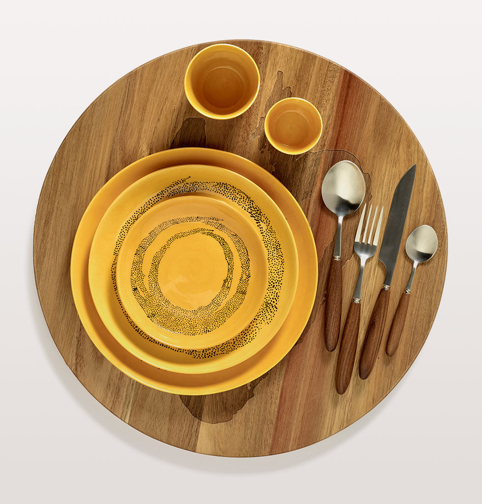 Ottolenghi x Serax | Sunny Yellow tableware | Sunny Yellow and Swirl Dots Black plates with sunny yellow tableware and Feast cutlery and wooden tray. wagreen.co.uk
