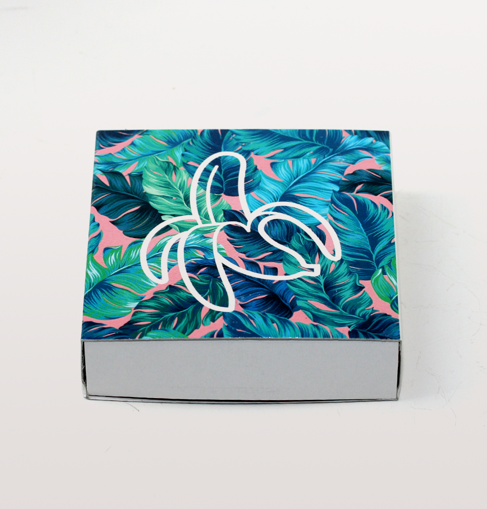 Box of luxury table matches. Square design with banana and tropical leaf green and pink