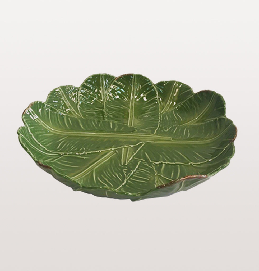 Banana Leaf Round Platter by Bordello Pinheiro. £115. Banana da Madeira Centrepiece green leaves dish