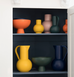 Group of Raawii ceramics featuring orange, yellow, pink, green and navy blue bowl, vase and jug from Strom collection