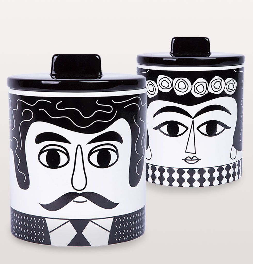 Add some character to your kitchen or bathroom with this happy Mexican duo Marisol and Carlos.  This hot couple will be happy anywhere in your home. Designed in a bold monochrome design these large storage jars are big enough to pop your hand into and the lid fits nice and snug too making them perfect for tea and coffee.    Black and white storage jar with black sealed lid.