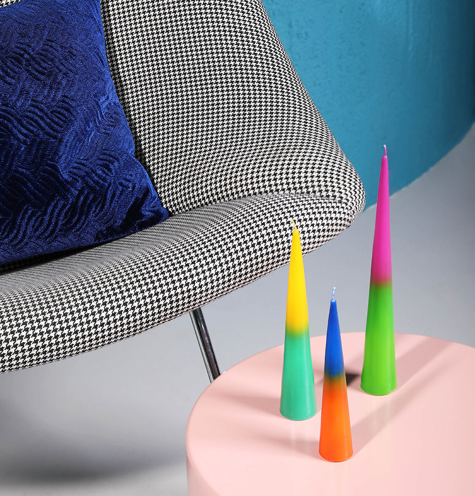 Set of three javelin shaped two tone candles in rainbow popping bright neon colours.  Create a colourful Christmas table with these stunning ombre coloured candles. Two tone colour combinations of yellow and turquoise, pink and green, orange and blue.  Presented in smart gift box.