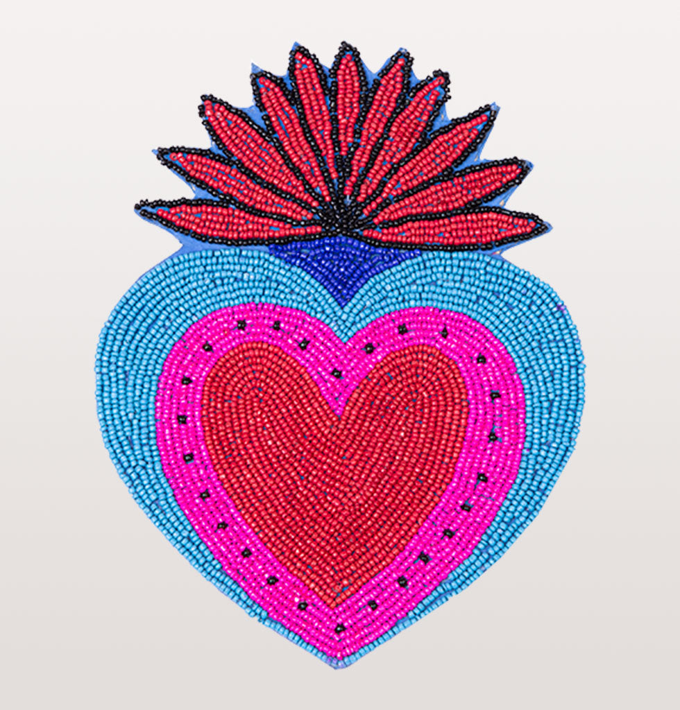 W.A.GREEN | KITSCH KITCHEN | Taking inspiration from Mexico, these brightly coloured oversized coasters are a fabulous way to spread the love at your table whilst entertaining or having a cosy night in. We have always been a fan of neon and these hand beaded heart shaped tablemats add a splash of colour to your table and your life.   Heart shaped Mexican milagro blue, pink, red and black beaded place mat coasters. £25 wagreen.co.uk